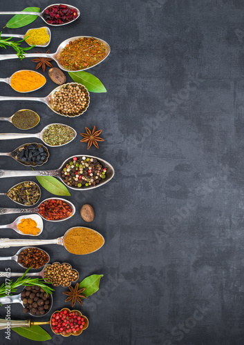 Various spices spoons on stone table. Top view . © bukhta79
