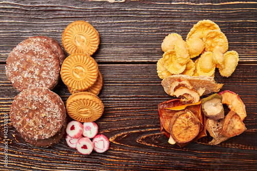 Poster Cookies, cornflakes and fruits. Choose a healthy lifestyle.