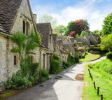 Fototapety A beautiful sunny morning in  Bibury,  Gloucestershir,  England, UK.  Old street with traditional cottages.