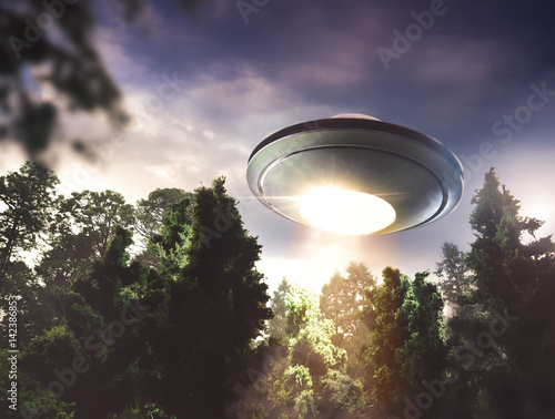 UFO flying over a forest Poster