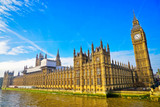 View of the Houses of Parliament with sunny sky in the background.