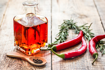 chili oil with ingredients on kitchen table background