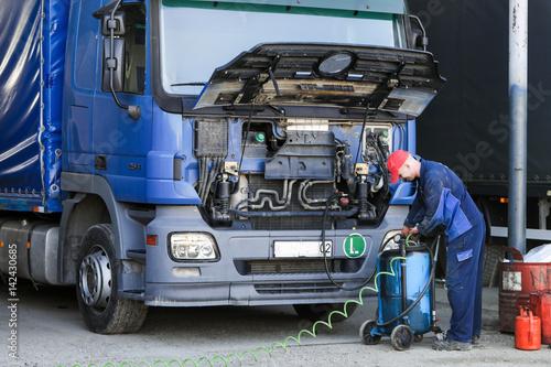 Mechanic repairing truck