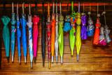 Folding umbrellas on hung
