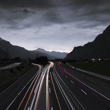 Gotthard in Europe. The way from Switzerland to Italy at night. Night Highway. Mountainous landscape. Central Switzerland, Gotthard Strasse.