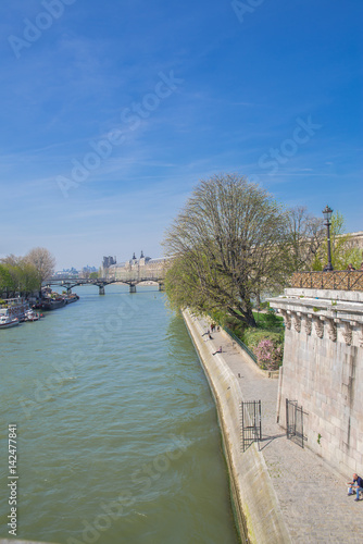 Paris, the Seine, view of the Pont des Arts, with the Louvre in background Poster