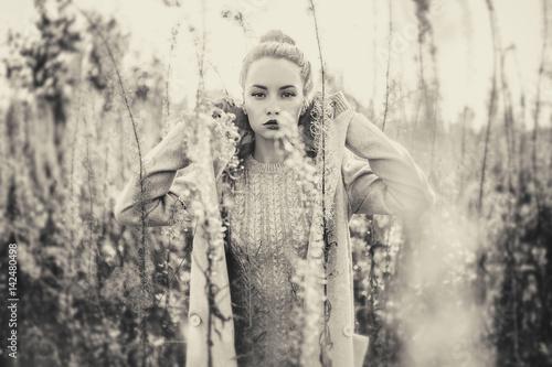 Fashion beautiful lady in autumn landscape - 142480498