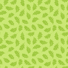 Seamless pattern. Oak leaves on a light green background. It can be used for printing on fabric, wallpaper and wrapping