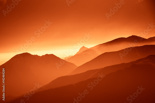 Poster Rood traf. A beautiful, colorful, abstract mountain landscape in a red tonality. Decorative, artistic look.