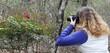 A Woman Photographs Red Berries, Cedar Ridge Preserve