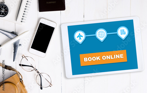 Book travel online on tablet for vacation
