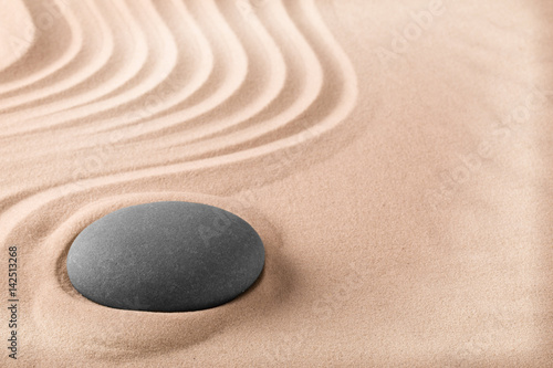 Spa wellness treathment background with sand and stone like for zen meditation. Relaxation and balance trough massage. Zen Buddhism garden...