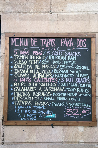 Colorful Tapas Spanish Menu on Wall in Barcelona, Spain
