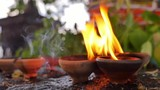 Spiritual background of burning candles in Buddhist temple. Flames and fumes of aromatic oil in South East Asia - 142546845