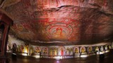 Dambulla cave temple or Golden Temple of Dambulla Sri Lanka World Heritage Site. Camera enters inside ancient Buddhist complex with beautiful sculptures, wall painting and religious decorations - 142546846