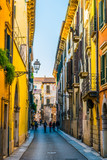 view of a narrow street in the italian city verona