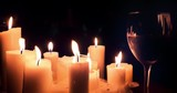 Many candles and glass of wine reflecting candlelight beautiful background - 142547658