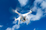 drone flying over sea. white drone hovering in a bright blue sky - 142553604