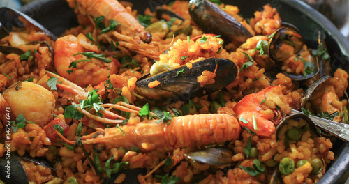 Extreme close up view of delicious Spanish seafood paella: mussels, king prawns, langoustine, haddock