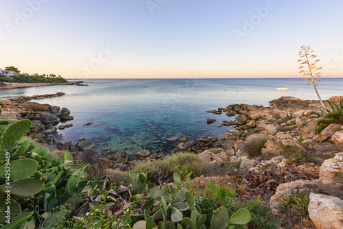 Aluminium Cyprus Evening view of sea view with immaculate water and blue sky, rocks, cactus plants and a boat at sunset, protaras, cyprus island