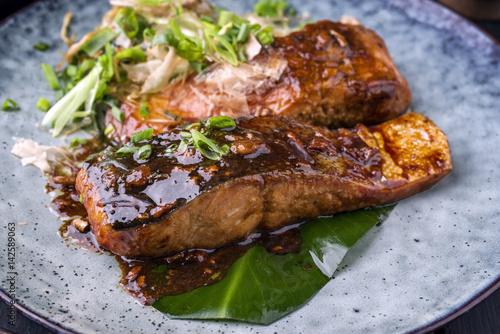 Traditional Japanese Salmon Teriyaki as close-up on Plate