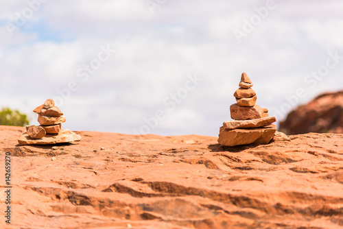 Stacks of rocks on red canyon in desert closeup