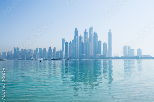 Hazy dubai marina skyline shot from the palm Poster