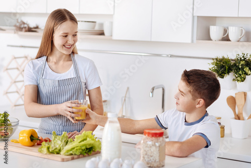 Cheerful siblings having a healthy breakfast © Viacheslav Iakobchuk