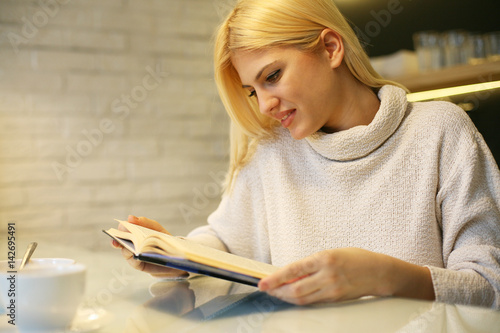 Woman reading a book. Poster