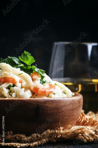Rice with seafood and white wine, selective focus