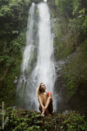Beautiful woman in red bikini and waterfall. - 142702868