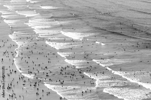 Surfers at the beach - 142703048
