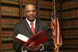 Lawyer in law library - 142704433