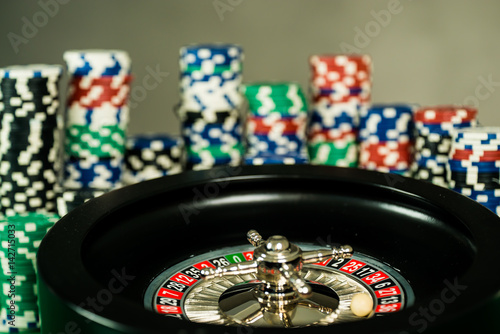 Poster Poker Chips on a gaming table roulette Casino theme background