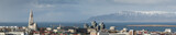 Fototapeta Panorama of Reykjavik skyline showing Hallgrimskirkja church cathedral and the mountains in the background.