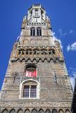 Belfry of Bruges in Belgium with blue sky