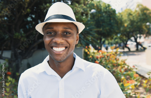 Happy african american man with hat