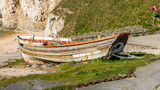 Old boat, seen at Flamborough North Landing, near Bridlington, East Riding of Yorkshire, UK