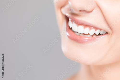 Beautiful smile young woman. White teeth on the master plan.