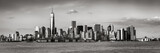 Lower Manhattan with the Financial District skyscrapers and Ellis Island. Panoramic view of New York City. Black & White - 142801493