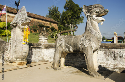Singha or Lion guardian statues with naga staircase at front of gate entrane at  Poster