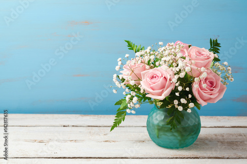 Beautiful rose flowers bouquet on wooden table with copy space Poster