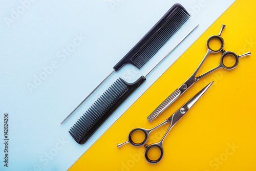 Professional hairdresser tools on yellow and blue background Poster