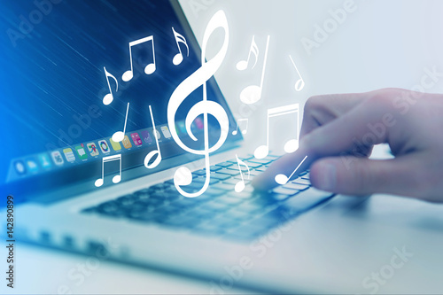 Concept of listenning music on a device - Technology concept - 142890899