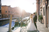 Tender bride and groom in a sunny day in Venice - 142893689