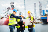 Shipbuilding engineers introducing new solution in a shipyard - 142917028