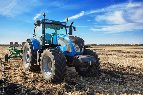 Juliste Tractor working in field