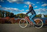 Fototapeta Girl biking in city