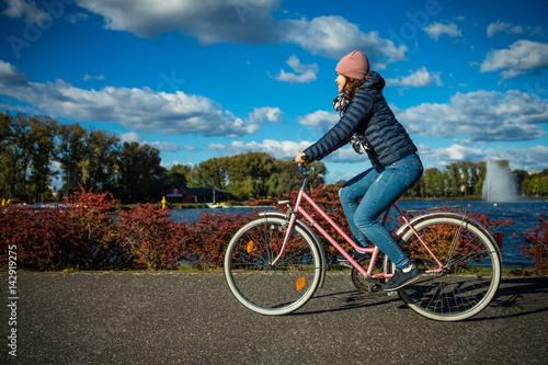Girl biking in city