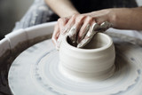 The woman's hands close up, the masterful studio of ceramics works with clay on a potter's wheel - 142921661